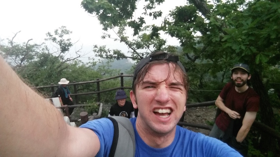 A satisfied, sweaty selfie after reaching the 836m peak of baegundae in Bukhansan park. (My friend Rich in the background)